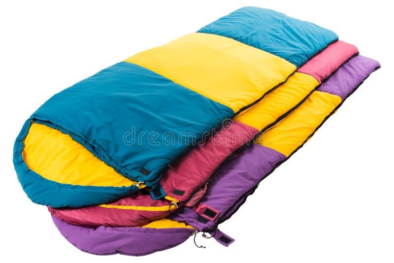 Sacos de dormir aislados en un fondo blanco imagen de archivo libre de regalías