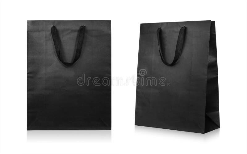 Sacos de papel isolados no fundo branco Saco de compra preto Trajeto de grampeamento imagens de stock