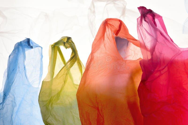 Sacos de plástico de cores usadas e transparentes imagem de stock royalty free
