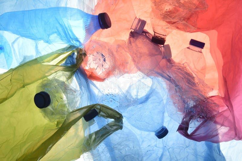 Sacos de plástico e garrafas imagens de stock royalty free