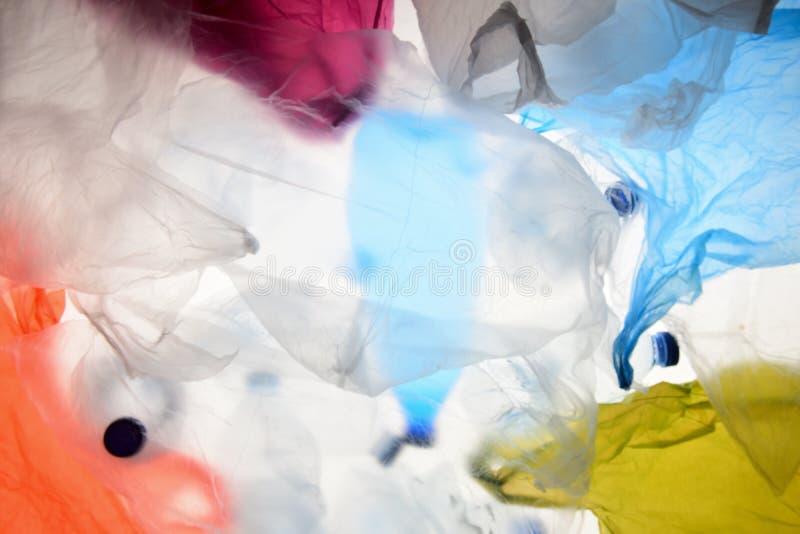 Sacos de plástico e garrafas fotografia de stock