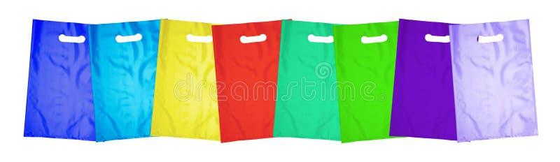 Sacos de plástico no branco foto de stock