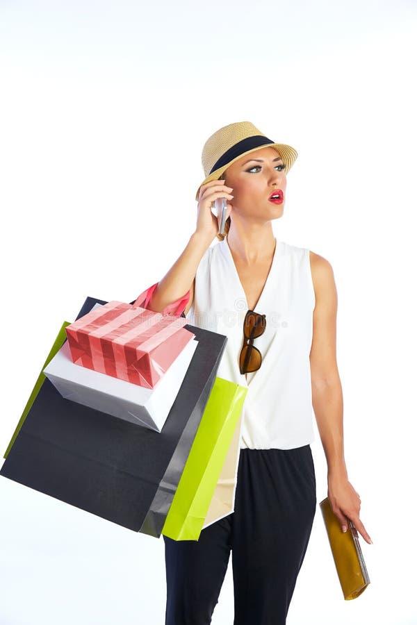 Sacos e smartphone shopaholic louros da mulher foto de stock royalty free