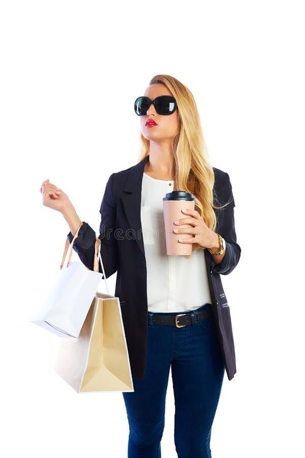 Sacos e smartphone shopaholic louros da mulher fotografia de stock