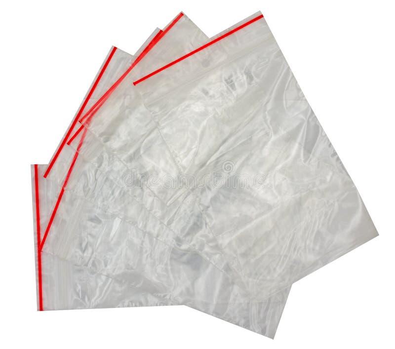 Sacos ziplock claros isolados no branco fotos de stock