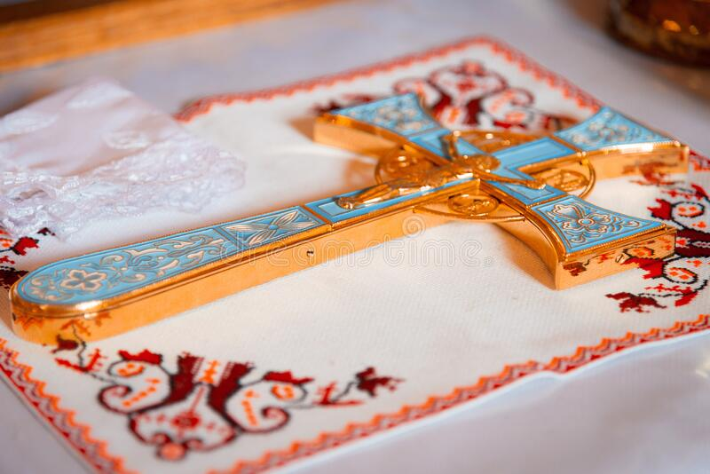 The Sacrament of Baptism. Attributes of the Orthodox priest for baptism, the cross. Baptism font stock photos