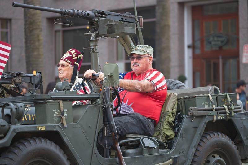 Sacramento Veterans Day Parade. Military jeep. Sacramento, California, United States - November 11, 2019: Veterans Day Parade. Veterans riding in their jeep royalty free stock photo
