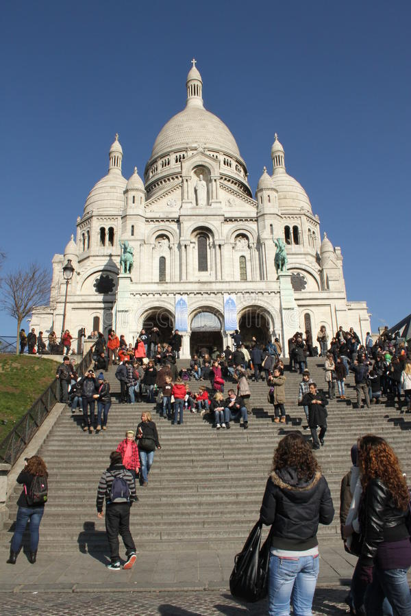 Sacre Coeur Basilica, Paris, France. Visitors and tourists on the steps of the famous landmark, the Sacre Coeur Basilica in Paris, France - Spring 2009 stock images