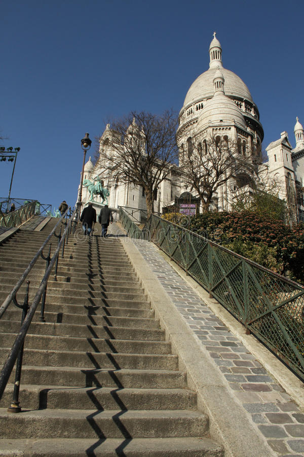 Sacre Coeur Cathedral and steps. Sacre Coeur Cathedral in Paris, looking up from the steps below stock image