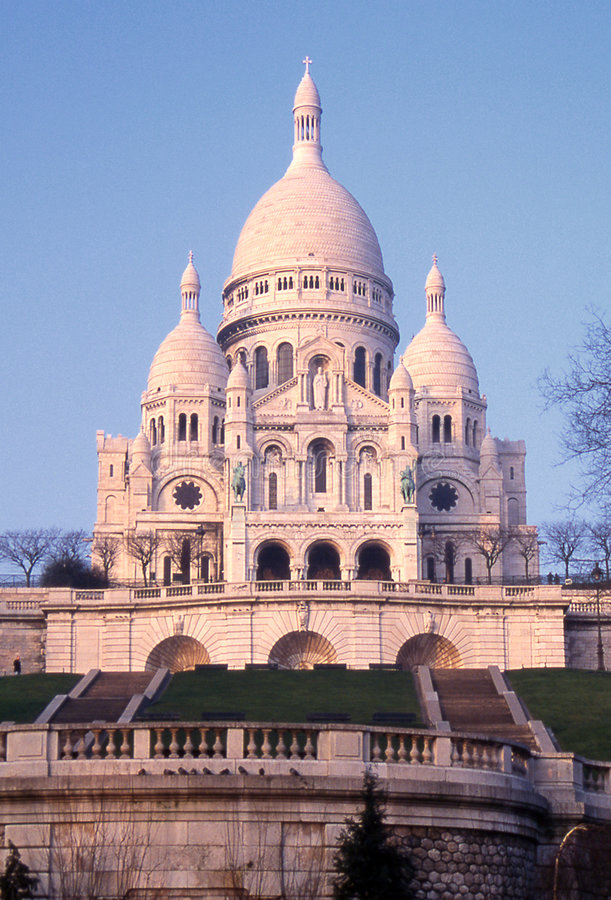 The Sacre-Coeur - Paris. The Sacre-Coeur basilica in Montmartre, Paris - In the pink light of evening royalty free stock image
