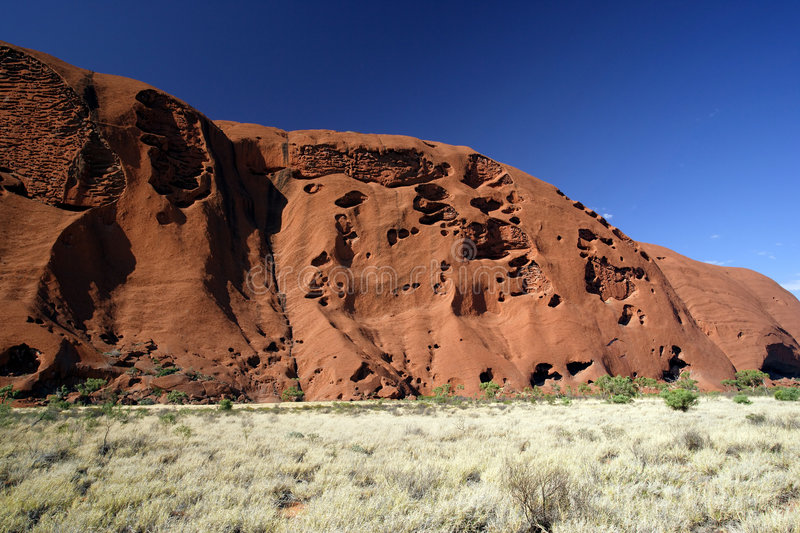 Sacred Ayers Rock. A section of Ayers Rock in the outback of Australia royalty free stock photography