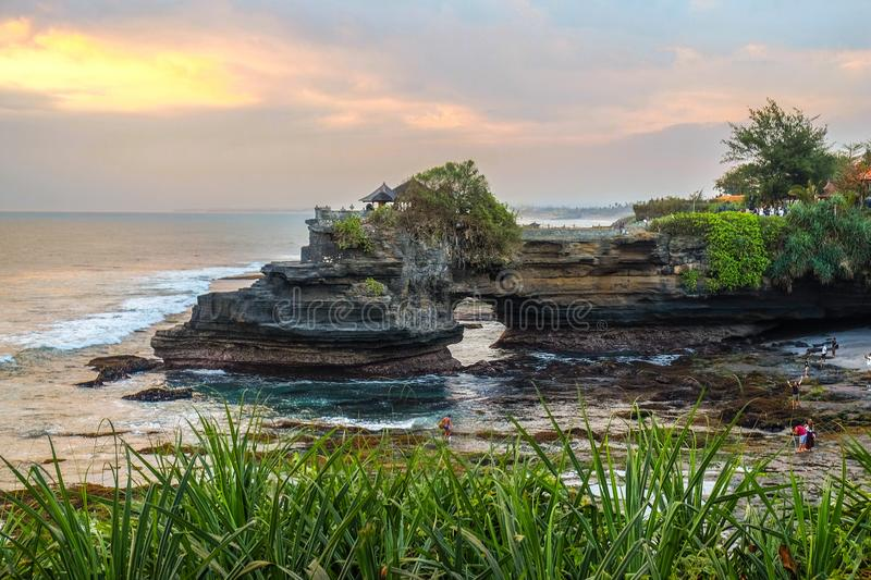 Sacred Balinese temple Tanah Lot. Pura Batu Bolong on the edge of a cliff at coastline with hole in rock royalty free stock photo