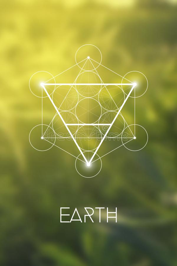 Sacred geometry Earth element symbol inside Metatron Cube and Flower of Life in front of natural blurry background royalty free illustration