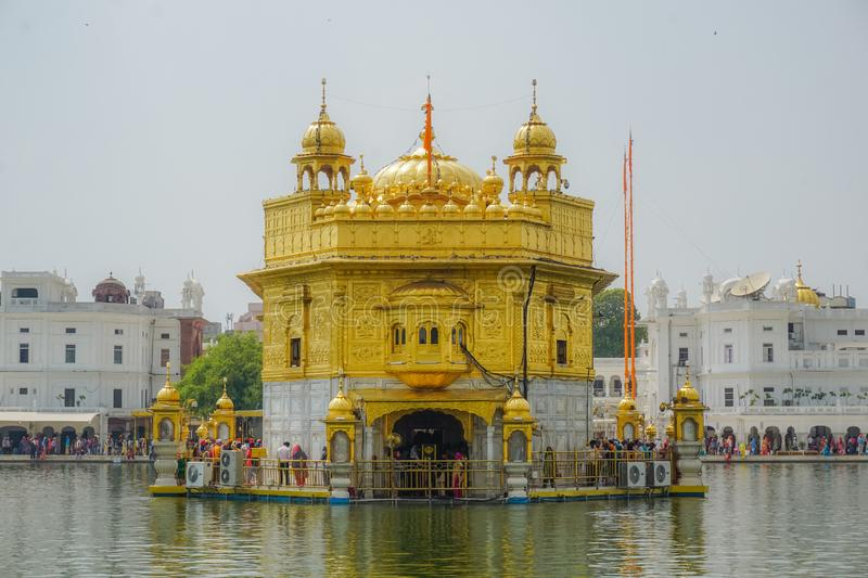 Amritsar, India - July 8, 2017: The sacred Golden Temple in the middle of the sacred lake. Every day tens of thousands of people a stock images
