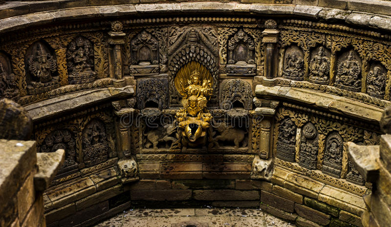 Temple. Sacred golden water fountain inside the palace in Lalitpur Nepal stock photo
