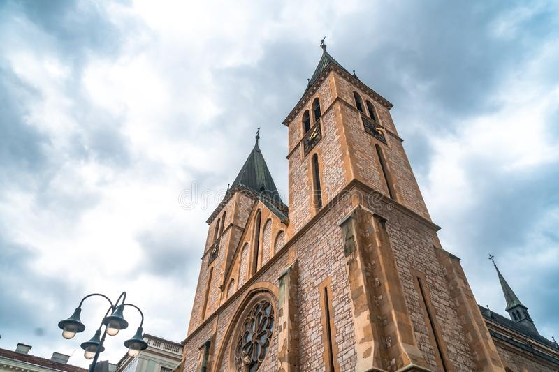 Sacred Heart Cathedral in Sarajevo. The sacred heart cathedral of Sarajevo with cloudy weather stock photo