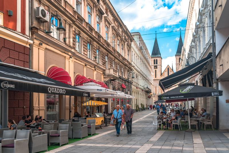Sacred Heart Cathedral in Sarajevo Streets. SARAJEVO, BOSNIA - AUGUST 3, 2019 : The sacred heart cathedral of Sarajevo The old town is most popular place for stock photography