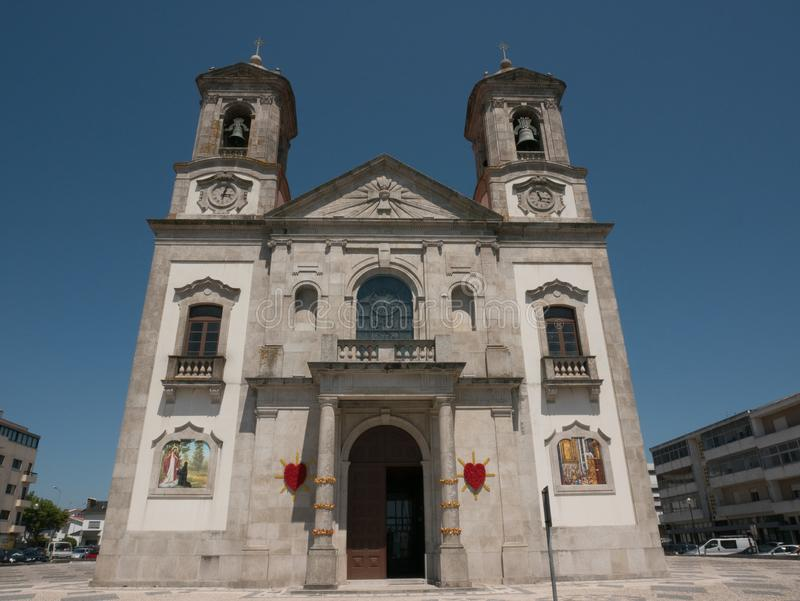 Sacred heart of Jesus church in Povoa de Varzim, Portugal. On a bright sunny day in summer with blue sky stock photography