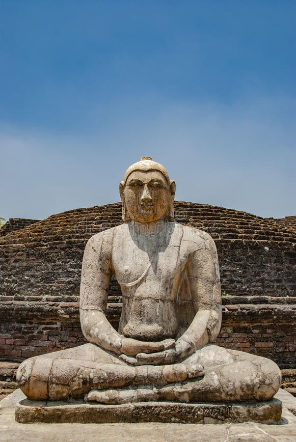 The sacred quadrangle with buddha, ancient ruins in Polonnaruwa in Sri Lanka. The sacred quadrangle with buddha in Polonnaruwa in Sri Lanka stock photos