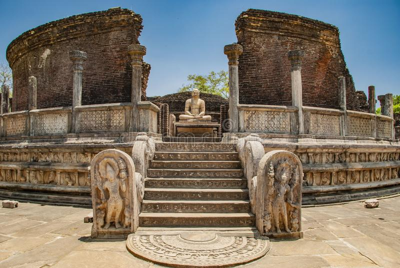 The sacred quadrangle with buddha, ancient ruins in Polonnaruwa in Sri Lanka. The sacred quadrangle with buddha in Polonnaruwa in Sri Lanka stock image