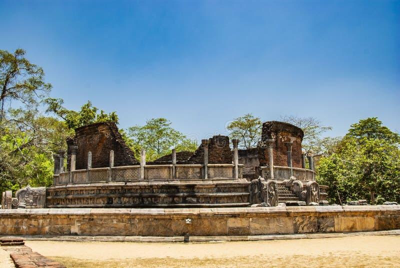The sacred quadrangle with buddha, ancient ruins in Polonnaruwa in Sri Lanka. The sacred quadrangle with buddha in Polonnaruwa in Sri Lanka royalty free stock photos