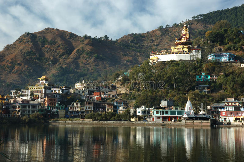 Sacred Rewalsar lake with big golden statue of Padmasambhava royalty free stock photo