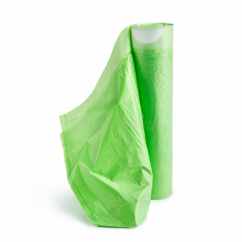 Sacs de déchets verts sur le fond blanc photographie stock