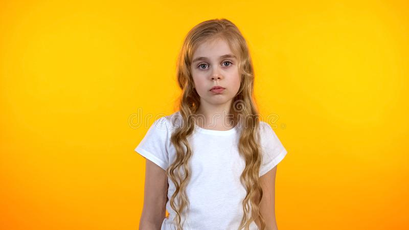 Sad adorable girl looking to camera, suffering lack of communication, no friends royalty free stock images