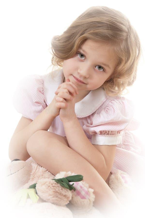 Sad adorable little blonde girl royalty free stock image