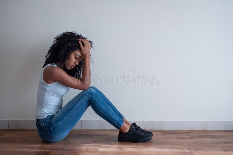 Young girl in trouble feeling sad and depressed royalty free stock image