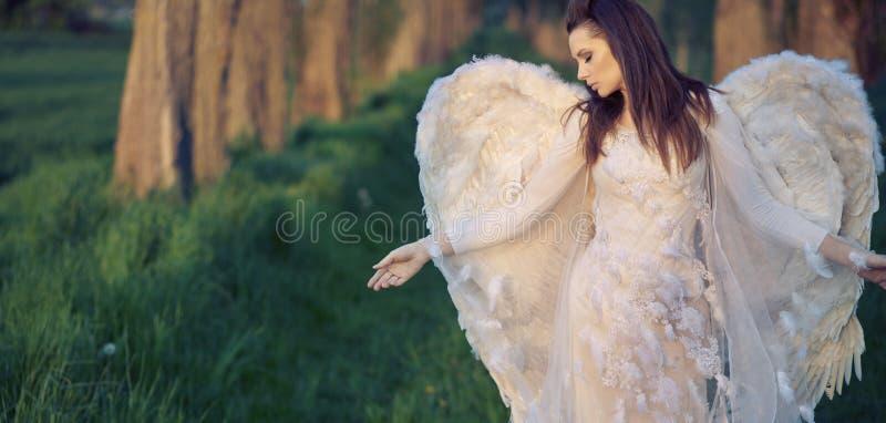Sad angel in the bosom of nature stock photo