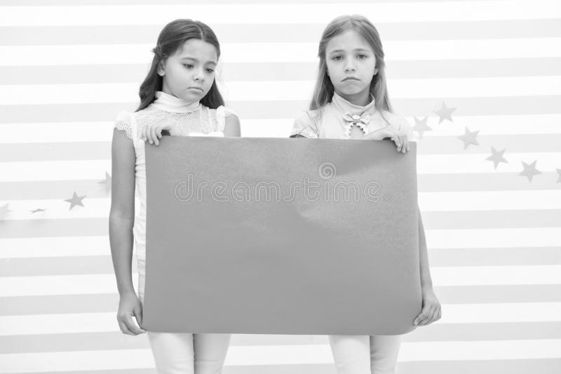 Sad announcement concept. Sorry for bad news. Girl hold advertising banner. Girls kids holding paper banner for. Announcement. Sad disappointed children with royalty free stock photos