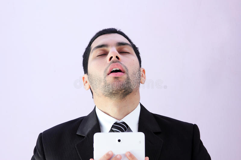 Sad arab business man tablet royalty free stock photography