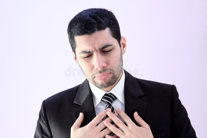 Sad arab business man. Wearing black suit stock photo