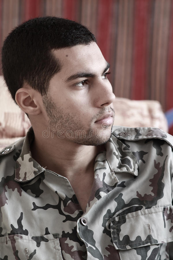 Sad arab egyptian young man in military suit stock photos