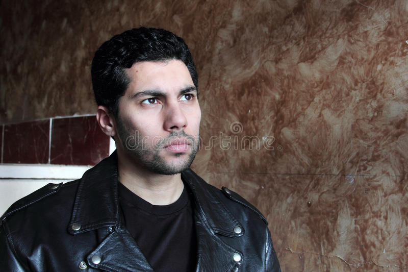 Sad arab young businessman in jacket stock photo