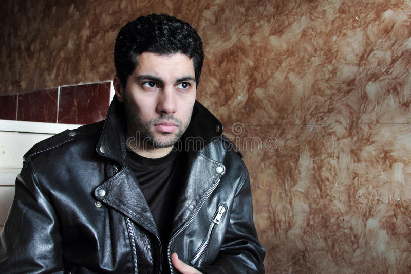 Sad arab young businessman in jacket stock photos