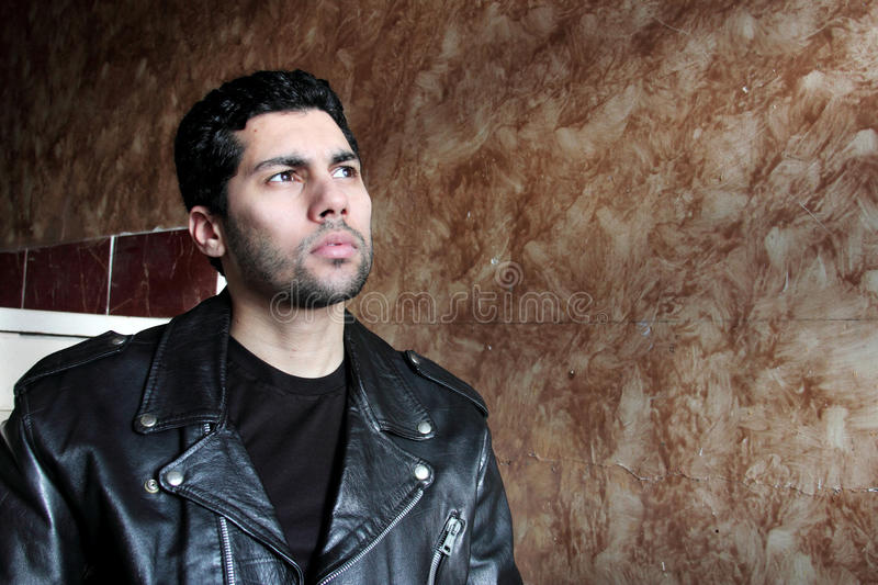 Sad arab young businessman in jacket royalty free stock photography