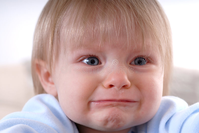 Sad Baby. Sad Crying Baby With Real Tears Running Down the Face royalty free stock photography