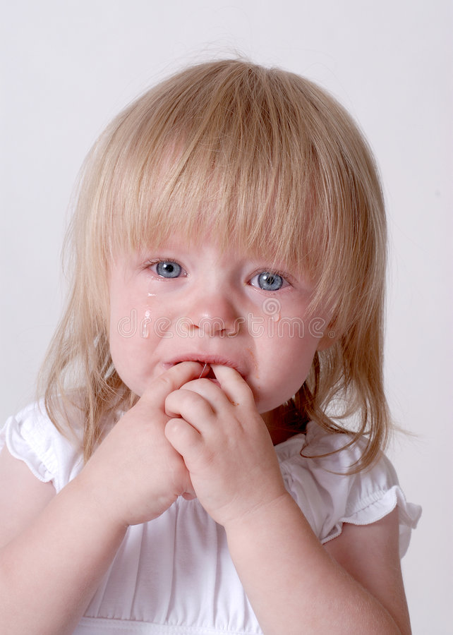 Sad Baby. Sad Crying Baby With Real Tears Running Down the Face royalty free stock image
