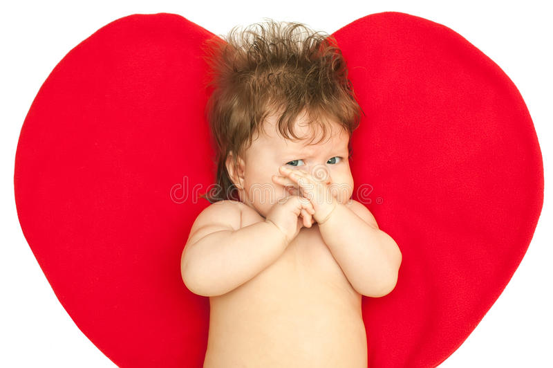 The sad baby against heart stock images