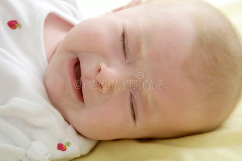 Sad Baby Crying Laying On The Bed Royalty Free Stock Photos