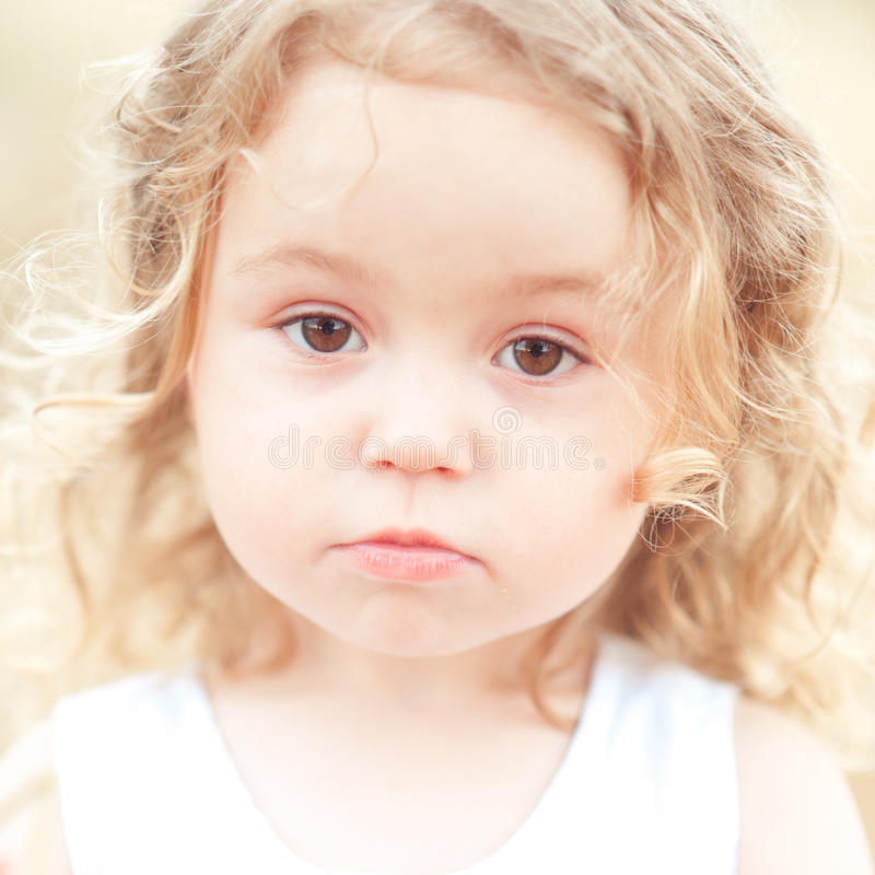 Sad baby girl outdoors stock image
