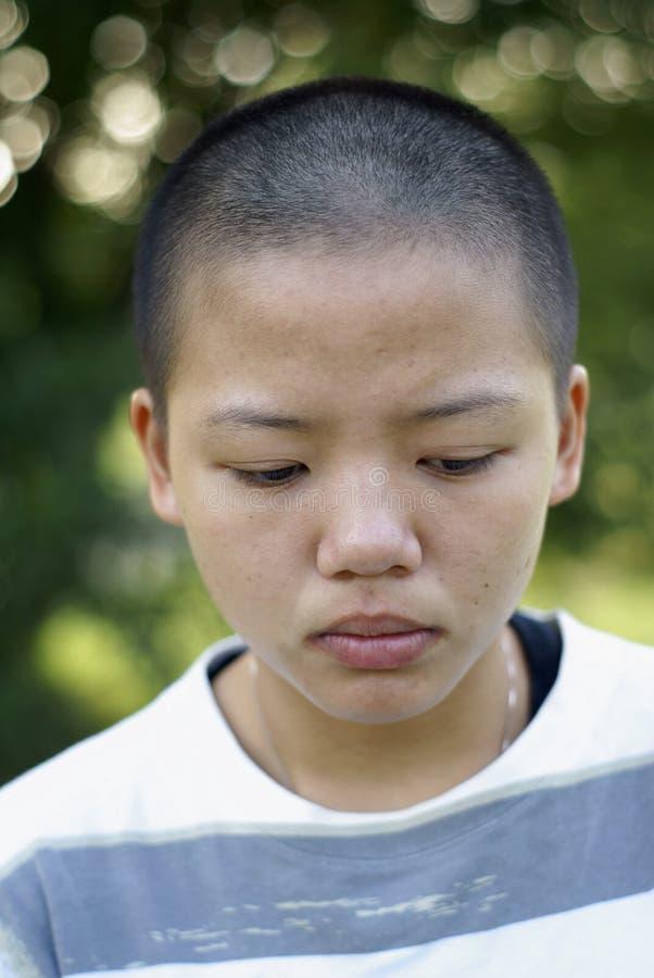 Sad bald asian teen girl royalty free stock photography