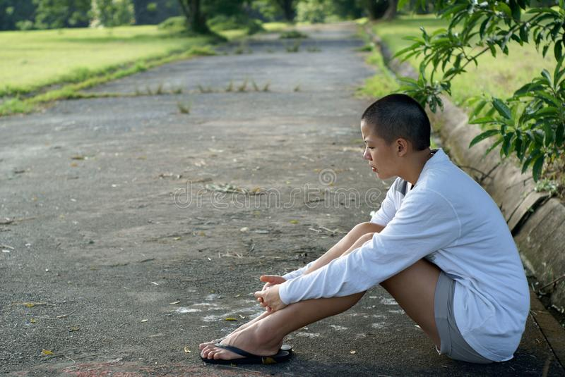 Download Sad Bald Asian Woman Seated Stock Photo - Image: 18903564