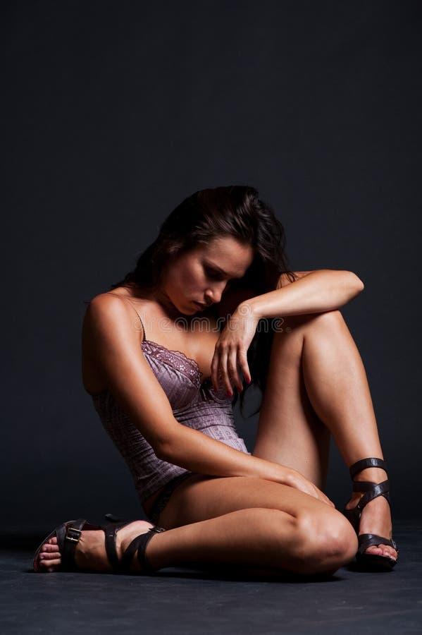 Sad Beautiful Woman Sitting On The Floor Royalty Free Stock Image