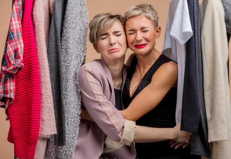 Sad beautiful young women are crying while shopping royalty free stock photography