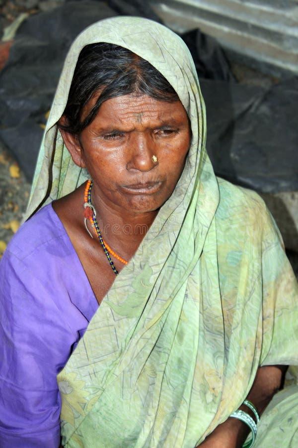 Sad Beggar Woman royalty free stock images