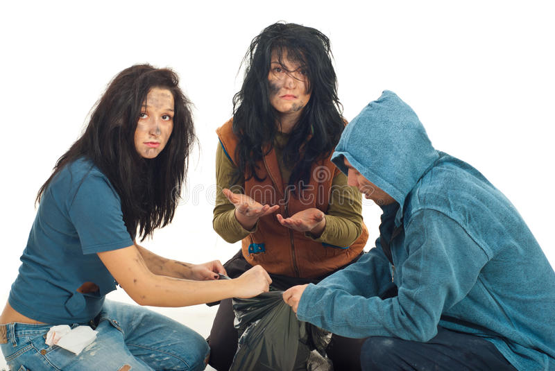 Sad Beggars Searching In Garbage Royalty Free Stock Images