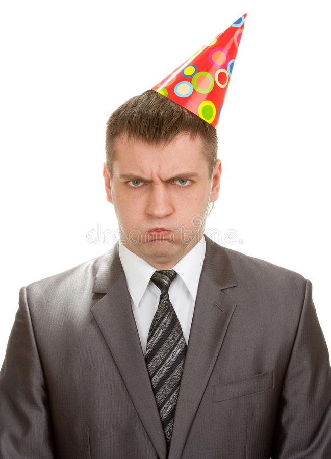 Sad birthday businessman in hat. Isolated on white royalty free stock photo